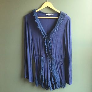 Dark blue knitted romper with bell sleeves